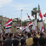 Syrians protest the Assad regime in Damascus